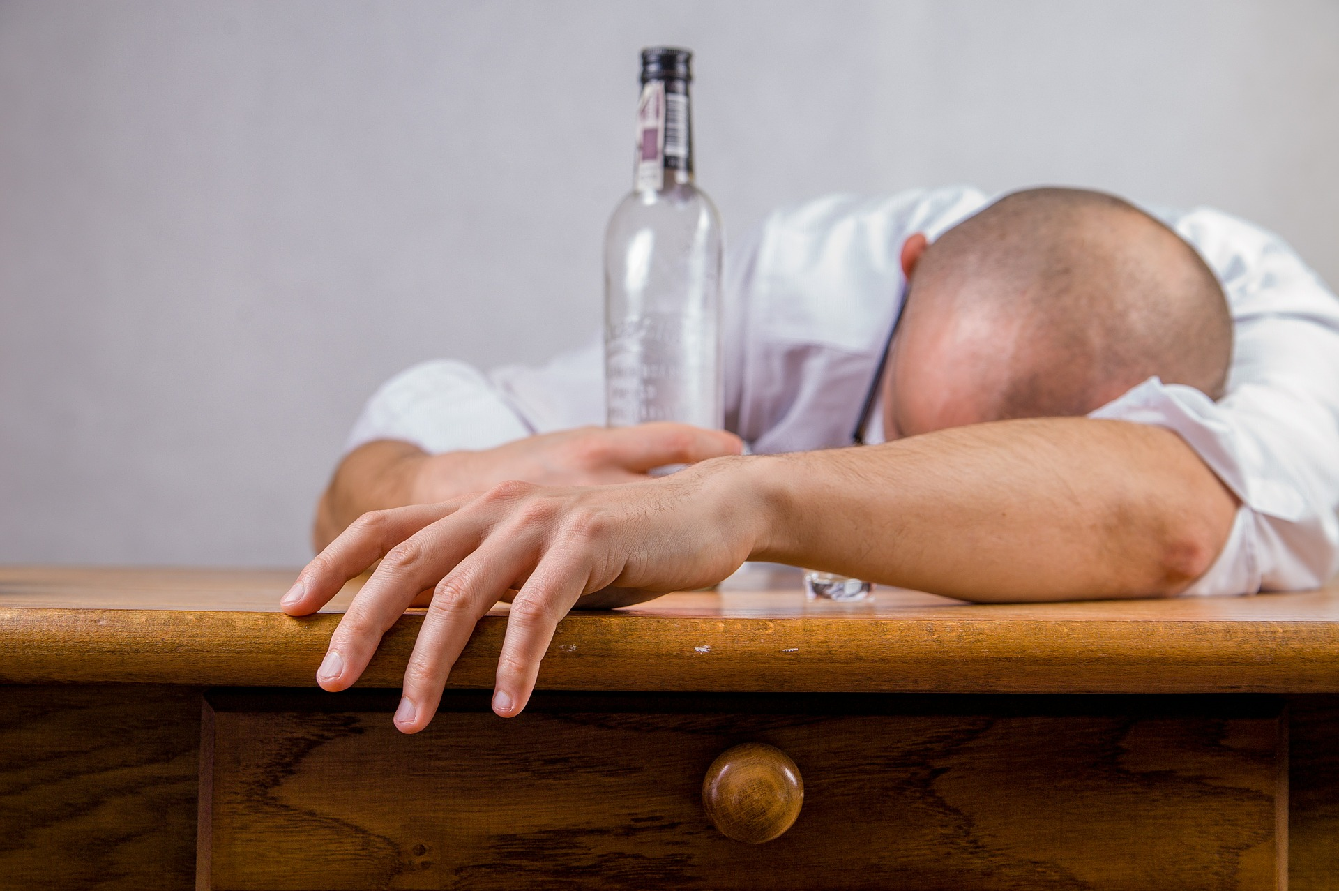 Man with empty bottle