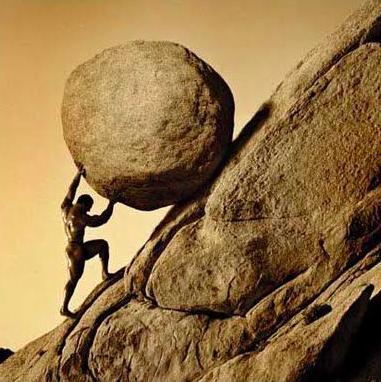 man pushing rock up a hill
