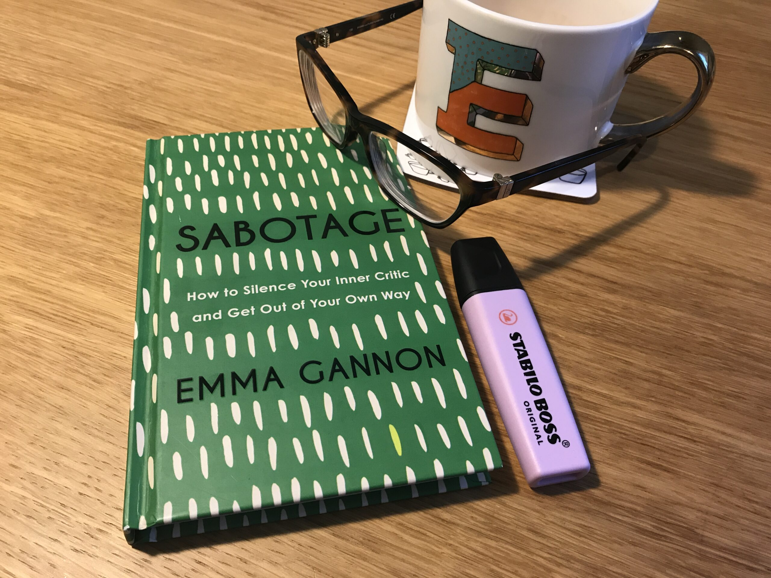 Book, mug, pen and glasses